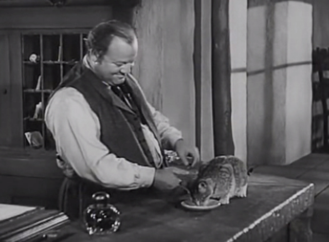Station West - hotel clerk Burl Ives feeding tabby cat on counter