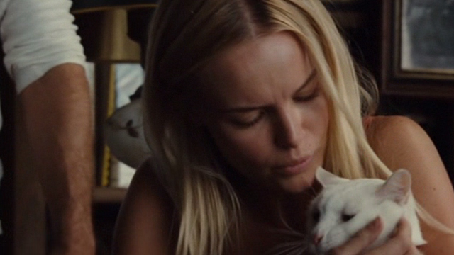 Straw Dogs 2011 - white cat Flutie being petted by Amy Kate Bosworth