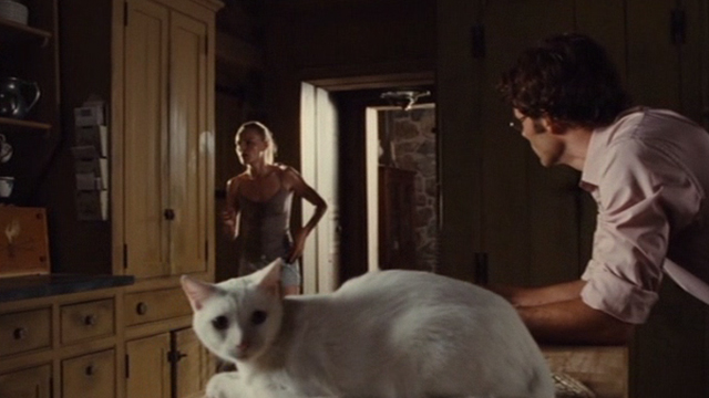 Straw Dogs 2011 - white cat Flutie sitting on counter with Amy Kate Bosworth and David James Marsden