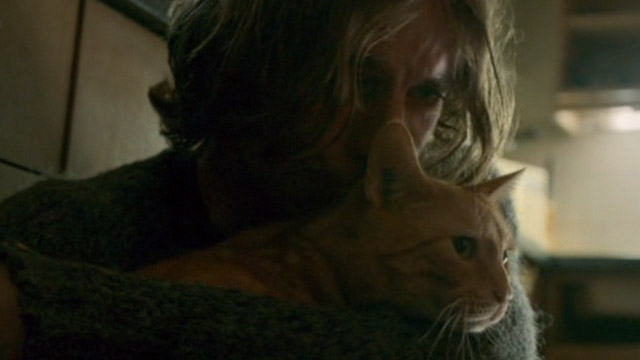 A Street Cat Named Bob - James Bowen Luke Treadway hugging orange tabby Bob