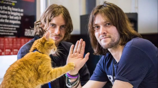 A Street Cat Named Bob - James Bowen and Luke Treadway with tabby Bob at book signing