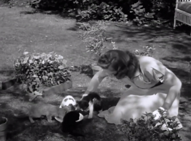 Strike Up the Band - Mary Judy Garland on grass with kittens drinking from saucer