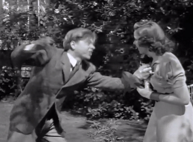 Strike Up the Band - Jimmy Mickey Rooney with Mary Judy Garland holding tuxedo kitten