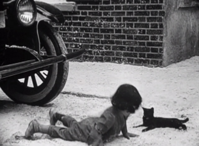 Such is Life - Baby Peggy lying next to black cat in street