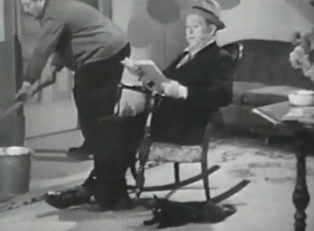 Sue My Lawyer - Harry Langdon sitting in rocking chair with black cat beside him on floor