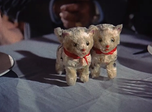 Summertime - pair of cat wind up toys on table