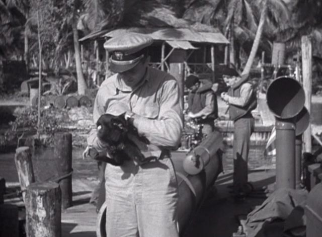 They Were Expendable - Shorty Donald Curtis holding and petting black cat