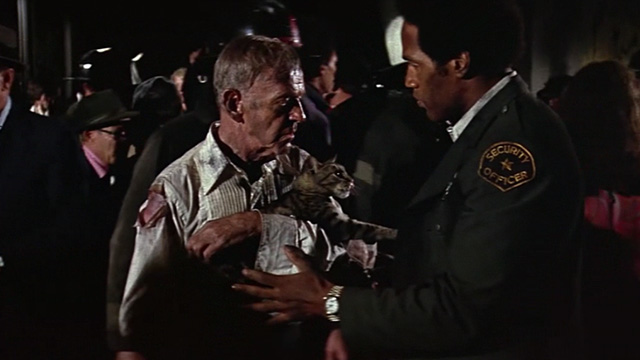 The Towering Inferno - tabby cat Elke being handed to Harlee Fred Astaire by Jernigan O.J. Simpson