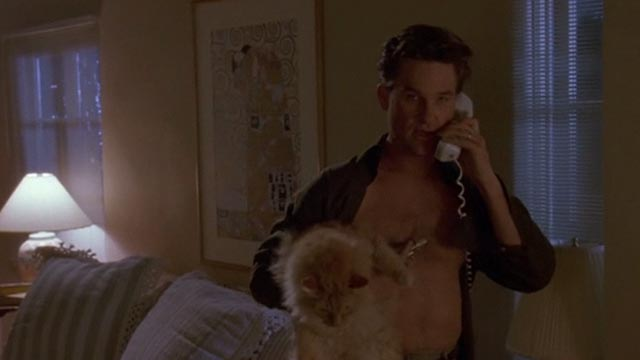 Unlawful Entry - Michael Kurt Russell holding orange long-haired tabby cat Tiny