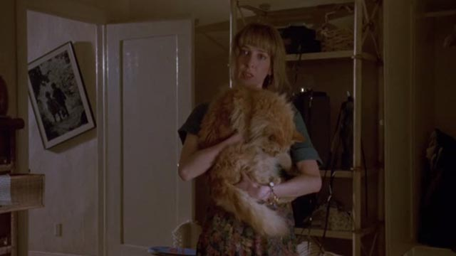 Unlawful Entry - Penny Deborah Offner holding orange long-haired tabby cat Tiny