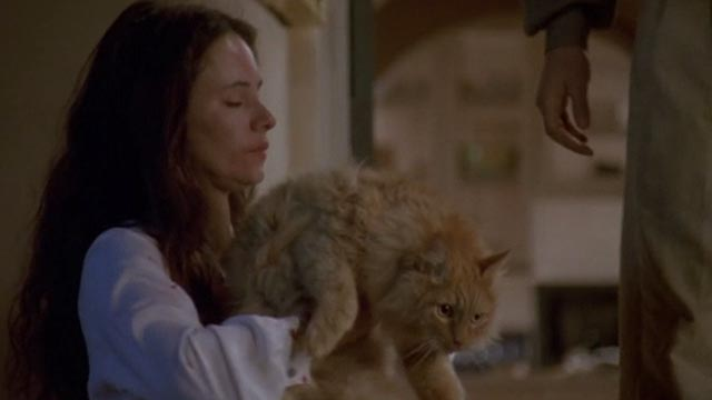 Unlawful Entry - Karen Madeleine Stowe holding orange long-haired tabby cat Tiny