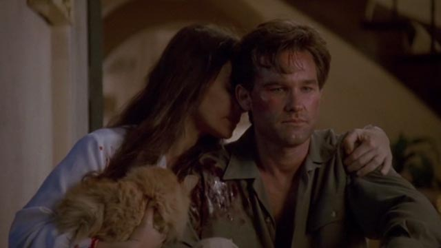 Unlawful Entry - Karen Madeleine Stowe holding orange long-haired tabby cat Tiny with Michael Kurt Russell
