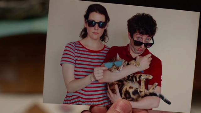 We'll Never Have Paris - photo of Quinn Simon Helberg and Devon Melanie Lynsky holding Bengal cat with sunglasses
