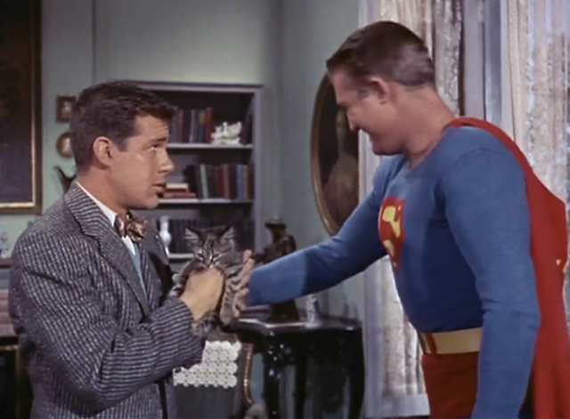 Adventures of Superman - Olsen's Millions - Superman George Reeves turns away after handing tabby kitten Topsy to Jimmy Olsen Jack Larson