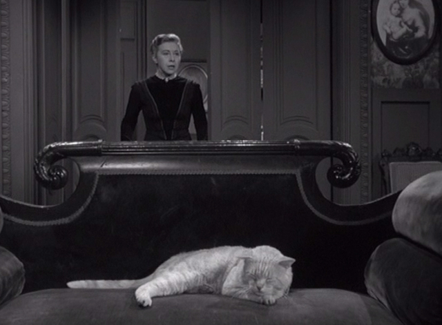 Alfred Hitchcock Presents - The Older Sister - Lizzie Borden Carmen Mathews entering room with orange tabby cat on couch