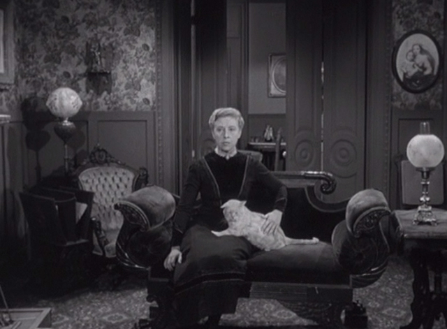 Alfred Hitchcock Presents - The Older Sister - Lizzie Borden Carmen Mathews sitting on couch with orange tabby cat