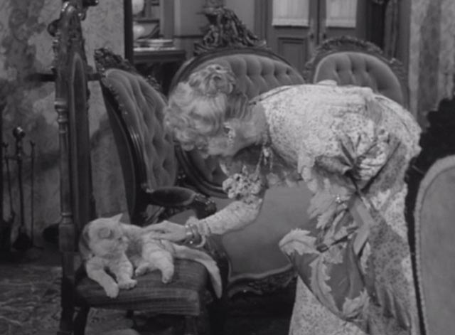 Alfred Hitchcock Presents - There Was an Old Woman - orangy tabby cat on chair behind Monica Laughton Estelle Winwood