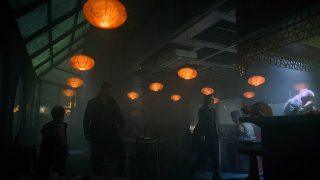 Altered Carbon - Man With My Face - ginger tabby cat on bar in Chinese restaurant as Kovacs Joel Kinnaman and Ortega Martha Higereda enter