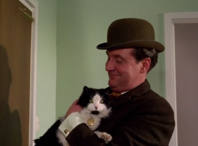 The Avengers - The Hidden Tiger - Steed Patrick Mcnee holding long haired tuxedo cat