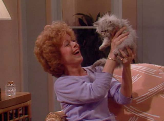Bosom Buddies - Only the Lonely - Ruth Holland Taylor holding up long-haired silver kitten