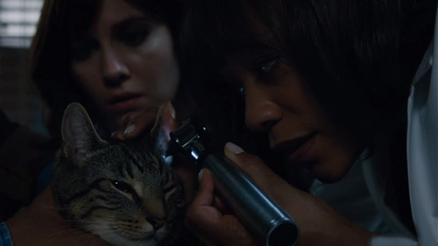 Brain Dead - Wake Up Grassroots Rochelle Nikki M. James and Laurel Mary Elizabeth Winstead check the ears of tabby cat Zeke