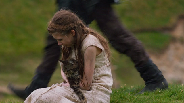 Britannia - Episode #1.1 - Cait Eleanor Worthington-Cox holding long-haired tabby cat