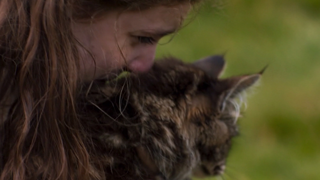 Britannia - Episode #1.1 - Cait Eleanor Worthington-Cox hugging long-haired tabby cat