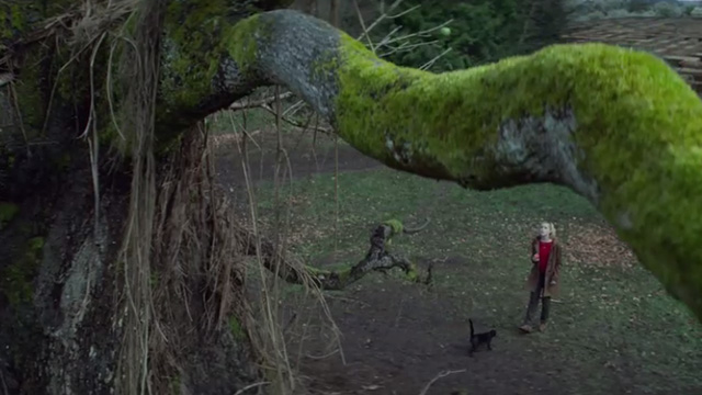 The Chilling Adventures of Sabrina - October Country - black cat Salem with Sabrina Kiernan Shipka in orchard