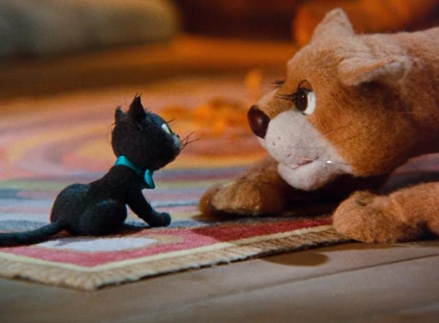 The Life and Adventures of Santa Claus - black cat Blinky and lioness Shiegra looking at each other