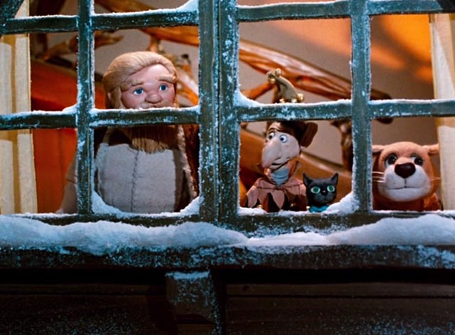 The Life and Adventures of Santa Claus - black cat Blinky and lioness Shiegra with Claus and Tingler looking out window