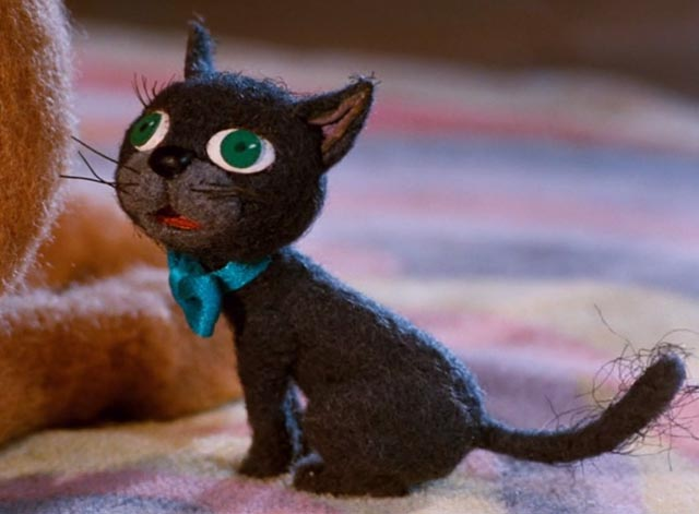 The Life and Adventures of Santa Claus - close up of black cat Blinky