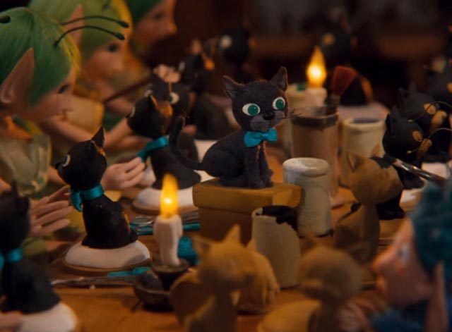 The Life and Adventures of Santa Claus - black cat Blinky posing as elves and fairies make toy cats