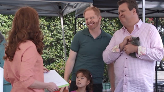 Modern Family - Bringing Up Baby - Mitchell Jesse Tyler Ferguson and Lily Aubrey Anderson-Emmons with Cameron Eric Stonestreet holding gray kitten at adoption fair