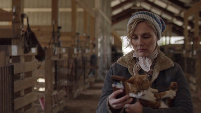 Nashville - Sometimes You Just Can't Win - Scarlett Clare Bowen holding orange and white cat and cell phone in stables