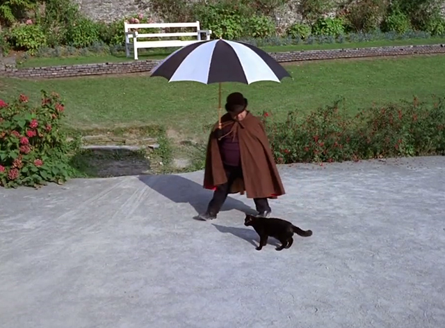 The Prisoner - Dance of the Dead black cat with man and umbrella passing by