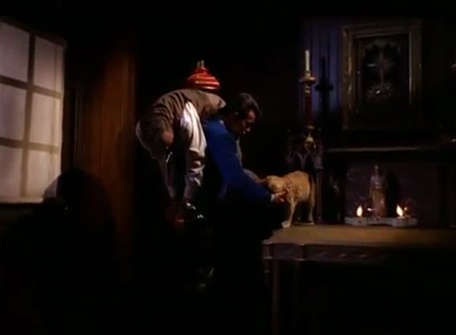 The Wild Wild West - The Night of the Fugitives - Jim West Robert Conrad pausing to pet ginger tabby cat