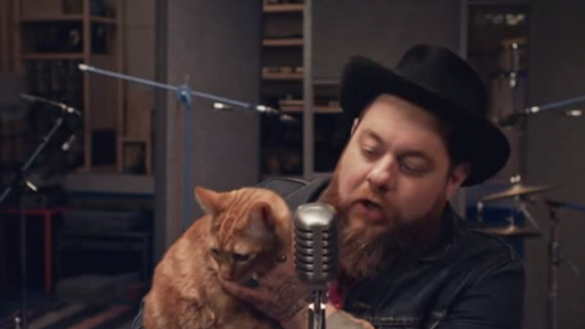 Nathaniel Rateliff and the Night Sweats - I Need Never Get Old - Nathaniel holding orange tabby cat while recording